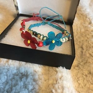 Other - A red and a blue handmade flower bracelets